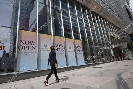 A woman walks past The Shops at Hudson Yards in Manhattan, New York. Mandatory credit: Kostas Lymperopoulos/CSM