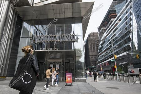 An overall view of The Neiman Marcus entrance to Hudson Yards as people walk past wearing face coverings in Manhattan, New York. Mandatory credit: Kostas Lymperopoulos/CSM