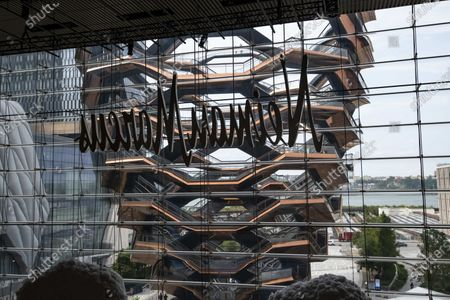 An overall view of The Vessel at Hudson Yards from behind The Neiman Marcus signage in Manhattan, New York. Mandatory credit: Kostas Lymperopoulos/CSM