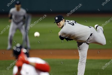 New York Yankees' Jordan Montgomery pitches during the first inning of the team's baseball game against the Boston Red Sox, in Boston