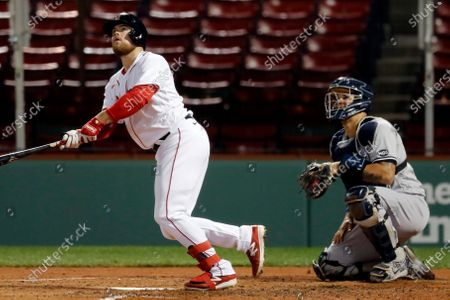 Boston Red Sox's Christian Arroyo watches his three-run home run in front of New York Yankees catcher Gary Sanchez during the fourth inning of a baseball game, in Boston