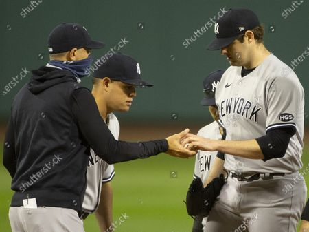 New York Yankees manger Aaron Boone (L) takes New York Yankees starting pitcher Jordan Montgomery (R) out of the game during the fifth inning of the MLB baseball game between the Boston Red Sox and the New York Yankees at Fenway Park in Boston, Massachusetts, USA, 18 September 2020.