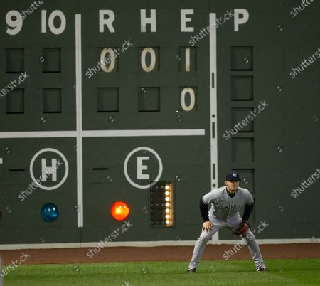 New York Yankees left fielder Clint Frazier stands in front of the scoreboard showing the charged error on New York Yankees starting pitcher Jordan Montgomery during the first inning of the MLB baseball game between the Boston Red Sox and the New York Yankees at Fenway Park in Boston, Massachusetts, USA, 18 September 2020.