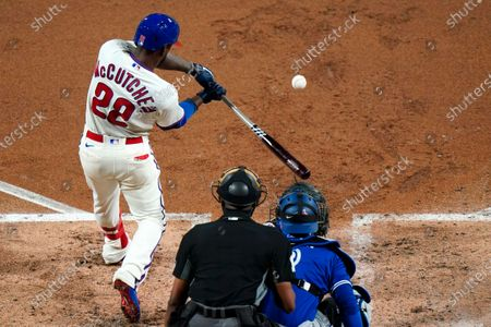 Philadelphia Phillies' Andrew McCutchen hits a home run off Toronto Blue Jays pitcher Ross Stripling during the third inning of the second baseball game in a doubleheader, in Philadelphia