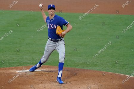 Texas Rangers starting pitcher Jimmy Herget throws during the first inning of the team's baseball game against the Los Angeles Angels, in Anaheim, Calif
