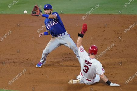 Texas Rangers shortstop Anderson Tejeda, left, catches the throw to second base to force out Los Angeles Angels' Taylor Ward on a grounder by Andrelton Simmons, who reached first during the second inning of a baseball game, in Anaheim, Calif
