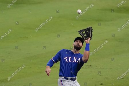 Texas Rangers right fielder Joey Gallo catches a foul ball hit by Los Angeles Angels' Mike Trout during the third inning of a baseball game, in Anaheim, Calif