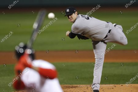 New York Yankees' Jordan Montgomery pitches during the first inning of a baseball game against the Boston Red Sox, in Boston