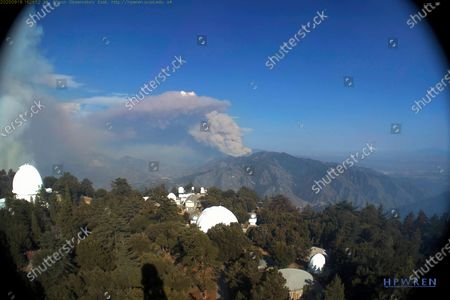This photo provided by High Performance Wireless Research and Education Network (HPWREN) and ALERTWildfire from a camera atop Mount Wilson shows the Bobcat fire that has moved away toward the northeast from the famed Southern California observatory, . Flames at one point came within 500 feet of the observatory but firefighters turned the flames away. It is now burning toward Juniper Hills and threatening the southern Antelope Valley