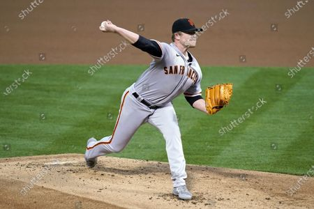 San Francisco Giants starting pitcher Logan Webb works in the first inning of a baseball game against the Oakland Athletics, in Oakland, Calif
