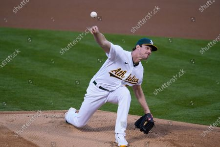 Oakland Athletics starting pitcher Chris Bassitt works in the first inning of a baseball game against the San Francisco Giants, in Oakland, Calif