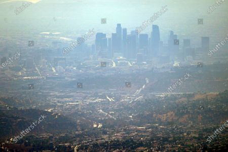 Smoke from the Bobcat fire fills the air over the Los Angeles skyline, from Mount Wilson, Calif