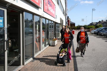 Early fans go for a look around the club shop prior to kick off