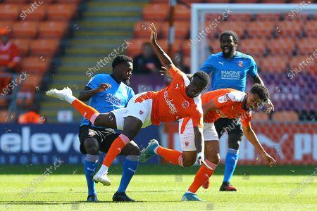 Diallang Jaiyesimi of Swindon and Blackpool's Bez Lubala
