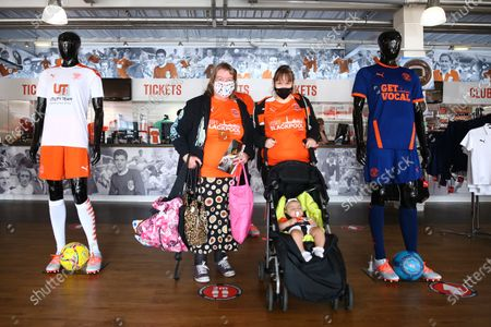 Fans in the club shop prior to kick off