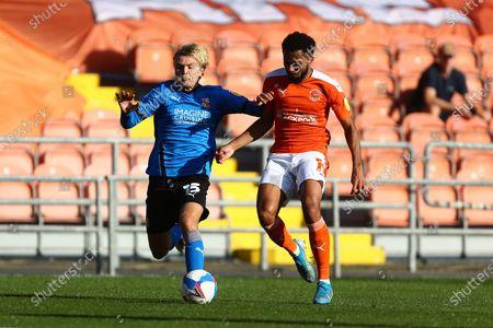 Matthew Smith of Swindon and Blackpool's Grant Ward