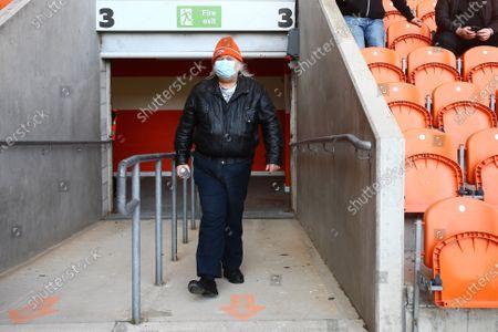 A Blackpool fan enters the stadium