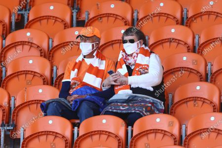 Mask wearing Blackpool fans in their seats