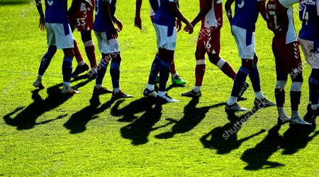 Shadows of players jostling for position in the  penalty box / Editor's Picks