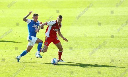 Paul Coutts of Fleetwood Town battles with Sammie Szmodics of Peterborough United