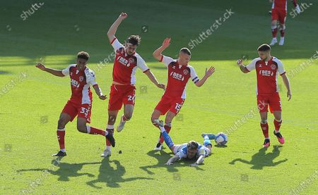 Sammie Szmodics of Peterborough United  goes under pressure from Paul Coutts of Fleetwood Town but no penalty is given