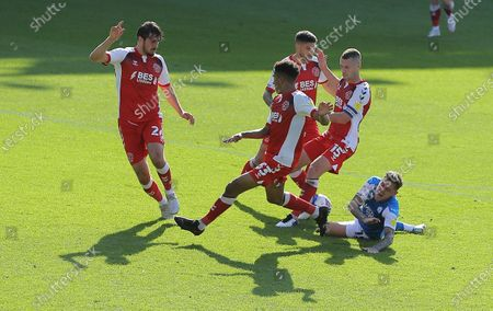 Sammie Szmodics of Peterborough United  goes down under pressure from Paul Coutts of Fleetwood Town but no penalty is given