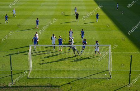 Alex Baptiste of Bolton Wanderers heads the ball past Colchester United Goalkeeper Dean Gerken, the goal was disallowed