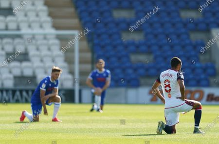 Brandon Comley of Bolton Wanderers takes a knee in support of the Black Lives Matter movement