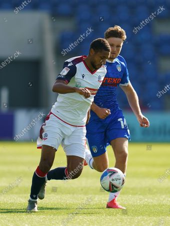 Noah Chilvers of Colchester United and Brandon Comley of Bolton Wanderers