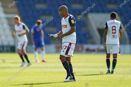 Alex Baptiste of Bolton Wanderers sprays himself with water