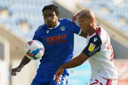 Jevani Brown of Colchester United and Alex Baptiste of Bolton Wanderers
