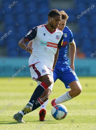 Brandon Comley of Bolton Wanderers and Noah Chilvers of Colchester United