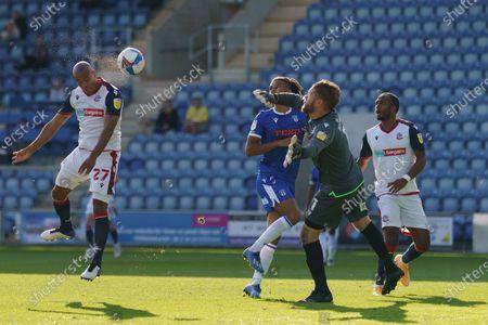 Alex Baptiste of Bolton Wanderers scores a goal past Colchester United Goalkeeper Dean Gerken which is then disallowed
