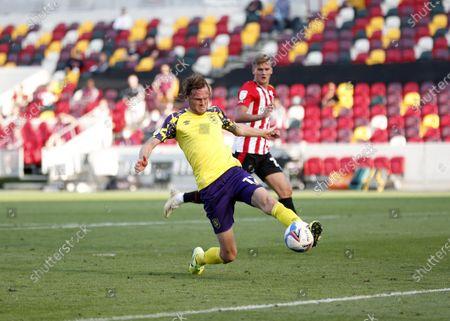 Richard Stearman of Huddersfield Town kicks the ball out; Brentford Community Park, London, England; EFL Championship Football, Brentford FC versus Huddersfield Town.