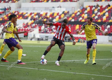 Ivan Toney of Brentford is marked by Romoney Crichlow-Noble and Richard Stearman of Huddersfield Town in the box; Brentford Community Park, London, England; EFL Championship Football, Brentford FC versus Huddersfield Town.