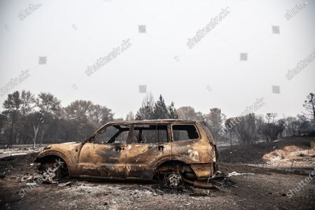 A general view of  a burned out car amid the aftermath of the Almeda Fire. The town of Phoenix, Oregon, showing the burned out homes, cars and rubble left behind. In Phoenix, about 20 miles north of the California border, homes were charred beyond recognition. Across the western US, at least 87 wildfires are burning, according to the National Interagency Fire Center. They've torched more than 4.7 million acres -- more than six times the area of Rhode Island.
