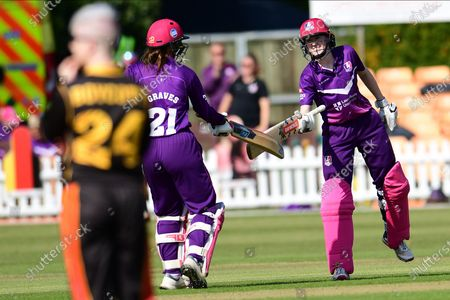 Sarah Bryce congratulates Teresa Graves of Lightning on her half century during the Rachael Heyhoe Flint Trophy match between Loughborough Lightning and Central Sparks at the Fischer County Ground, Grace Road, Leicester