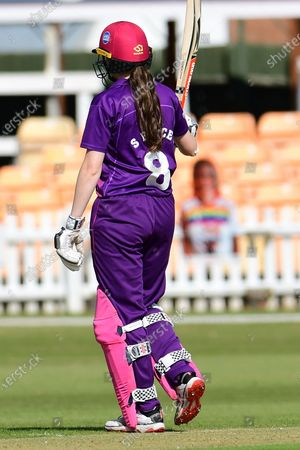 Sarah Bryce of Lightning celebrates her half century during the Rachael Heyhoe Flint Trophy match between Loughborough Lightning and Central Sparks at the Fischer County Ground, Grace Road, Leicester