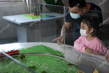 A girl and her parent visit the Hefei Institutes of Physical Science of the Chinese Academy of Sciences during an event for the National Science Day in Hefei, capital of east China's Anhui Province, Sept. 19, 2020.
