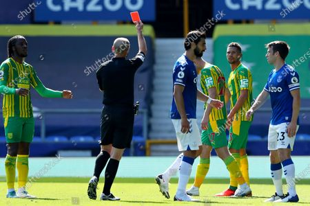 Stock Picture of Referee Mike Dean shows a red card to West Bromwich Albion's Kieran Gibbs, 2nd right, during the English Premier League soccer match between Everton and West Bromwich Albion at Goodison Park in Liverpool, England