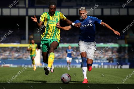West Bromwich Albion's Semi Ajayi vies for the ball with Everton's Richarlison, right, during the English Premier League soccer match between Everton and West Bromwich Albion at Goodison Park in Liverpool, England