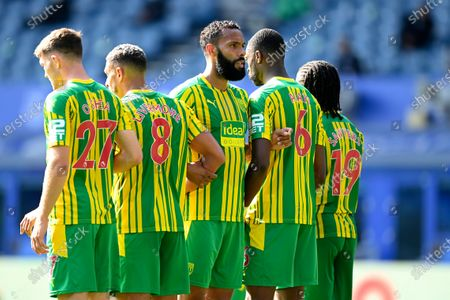 West Bromwich Albion's Kyle Bartley, center, joins his teammates forming a barrier during the English Premier League soccer match between Everton and West Bromwich Albion at Goodison Park in Liverpool, England