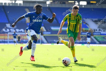 Everton's Moise Kean vies for the ball with West Bromwich Albion's Dara O'Shea, right, during the English Premier League soccer match between Everton and West Bromwich Albion at Goodison Park in Liverpool, England