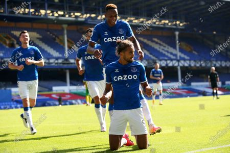 Everton's Dominic Calvert-Lewin celebrates after scoring his side's fifth goal during the English Premier League soccer match between Everton and West Bromwich Albion at Goodison Park in Liverpool, England