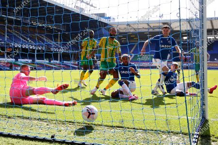 Everton's Michael Keane, foreground right, scores his side's third goal during the English Premier League soccer match between Everton and West Bromwich Albion at Goodison Park in Liverpool, England