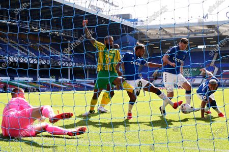Everton's Michael Keane, 2nd right, scores his side's third goal during the English Premier League soccer match between Everton and West Bromwich Albion at Goodison Park in Liverpool, England