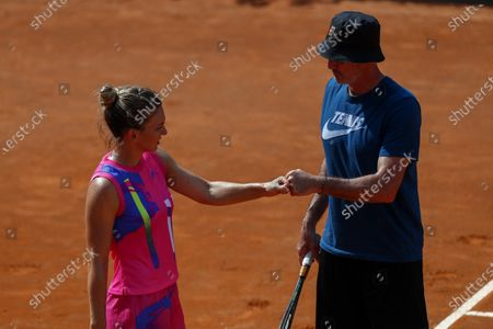 Simona Halep of Romania celebrates with her coach Darren Cahill after her women's singles quarter-finals round match against Yulia Putintseva of Kazakhstan at the Italian Open tennis tournament in Rome, Italy, 19 September 2020.