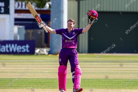 Stock Image of 100 - Sarah Bryce acknowledges her team mates on reaching 100 during the Rachael Heyhoe Flint Trophy match between Loughborough Lightning and Central Sparks at the Fischer County Ground, Grace Road, Leicester