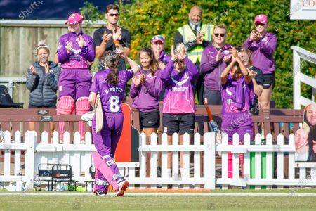 Sarah Bryce leaves the field to the applause of her team mates scoring 117 no during the Rachael Heyhoe Flint Trophy match between Loughborough Lightning and Central Sparks at the Fischer County Ground, Grace Road, Leicester