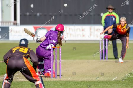 Sarah Bryce hits a boundary off Issy Wong during the Rachael Heyhoe Flint Trophy match between Loughborough Lightning and Central Sparks at the Fischer County Ground, Grace Road, Leicester